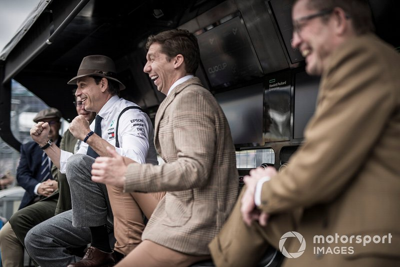 Toto Wolff, Executive Director (Business), Mercedes AMG, and Mercedes team mates on the pit wall