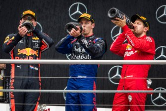 Race winner Max Verstappen, Red Bull Racing, Daniil Kvyat, Toro Rosso and Sebastian Vettel, Ferrari celebrate on the podium with the champagne
