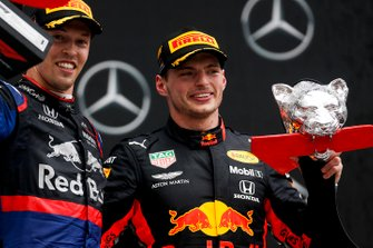 Third place Daniil Kvyat, Toro Rosso and race winner Max Verstappen, Red Bull Racing on the podium with the trophy