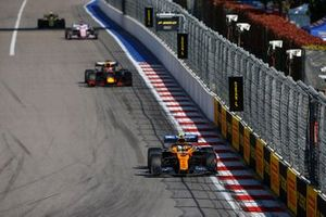 Lando Norris, McLaren MCL34, leads Max Verstappen, Red Bull Racing RB15, Sergio Perez, Racing Point RP19, and Kevin Magnussen, Haas F1 Team VF-19