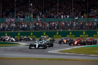 Valtteri Bottas, Mercedes AMG W10, leads Lewis Hamilton, Mercedes AMG F1 W10, Charles Leclerc, Ferrari SF90, Max Verstappen, Red Bull Racing RB15, Sebastian Vettel, Ferrari SF90, Pierre Gasly, Red Bull Racing RB15, and the rest of the field at the start