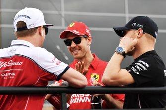 Kimi Raikkonen, Alfa Romeo Racing, Sebastian Vettel, Ferrari, and Valtteri Bottas, Mercedes AMG F1, in the drivers parade