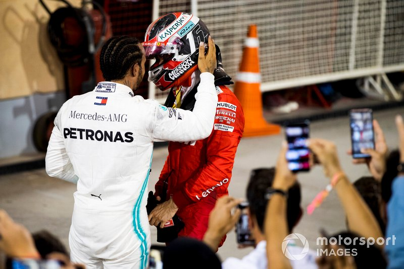 Lewis Hamilton, Mercedes AMG F1, 1st position, talks with Charles Leclerc, Ferrari, 3rd position, after the race