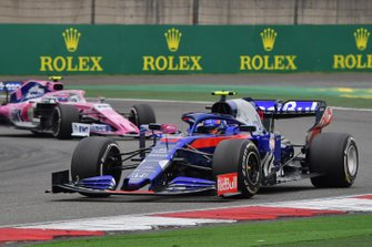 Alexander Albon, Toro Rosso STR14, leads Lance Stroll, Racing Point RP19
