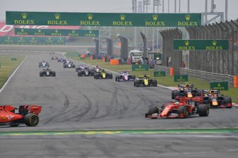 Charles Leclerc, Ferrari SF90, leads Sebastian Vettel, Ferrari SF90, Max Verstappen, Red Bull Racing RB15, Pierre Gasly, Red Bull Racing RB15, Daniel Ricciardo, Renault F1 Team R.S.19, Sergio Perez, Racing Point RP19, and the remainder of the field on the opening lap