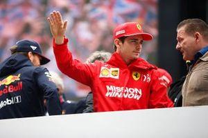 Charles Leclerc, Ferrari, talks to Jos Verstappen