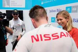 Jean-Eric Vergne, DS TECHEETAH, looks on as Oliver Rowland, Nissan e.Dams, is interviewed by TV Presenter Nicki Shields