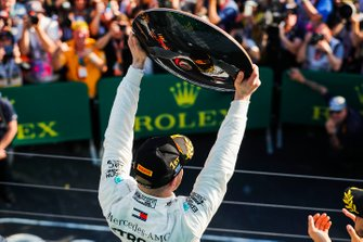 Valtteri Bottas, Mercedes AMG F1, 1st position, celebrates with his trophy on the podium