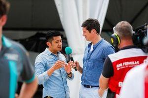 Pundit Ho-Pin Tung speaks to TV Presenter Vernon Kay