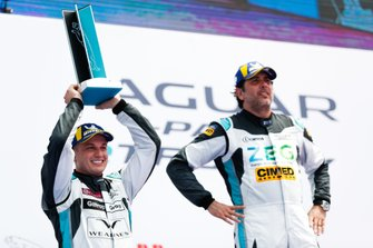 Simon Evans, Team Asia New Zealand, receives his trophy on the podium, next to Cacá Bueno, Jaguar Brazil Racing
