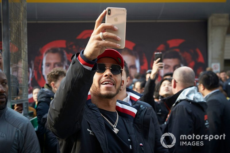 Lewis Hamilton, Mercedes AMG F1, takes a photo with fans