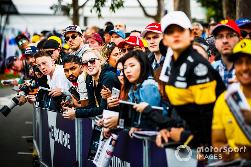 Fans wait for autographs from the drivers
