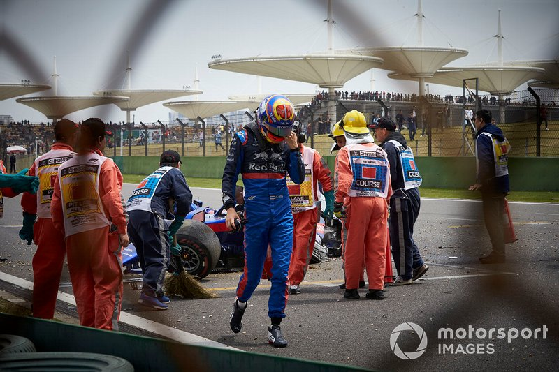 Alexander Albon, Toro Rosso, walks away from his car after losing control and hitting a barrier