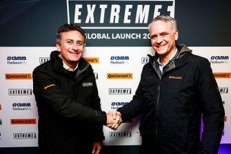 Alejandro Agag, CEO, Formula E, shakes hands with a Continental Tyres representative