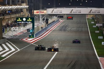 Pierre Gasly, Red Bull Racing RB15, leads Kevin Magnussen, Haas F1 Team VF-19, and Alexander Albon, Toro Rosso STR14