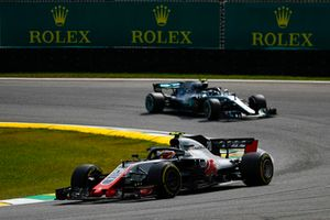 Kevin Magnussen, Haas F1 Team VF-18, leads Max Verstappen, Red Bull Racing RB14
