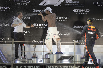 Bradley Lord, Head of Mercedes-Benz Motorsport Communications, Lewis Hamilton, Mercedes AMG F1 and Max Verstappen, Red Bull Racing celebrate on the podium with the champagne