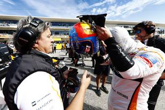 Fernando Alonso, McLaren, puts is helmet on