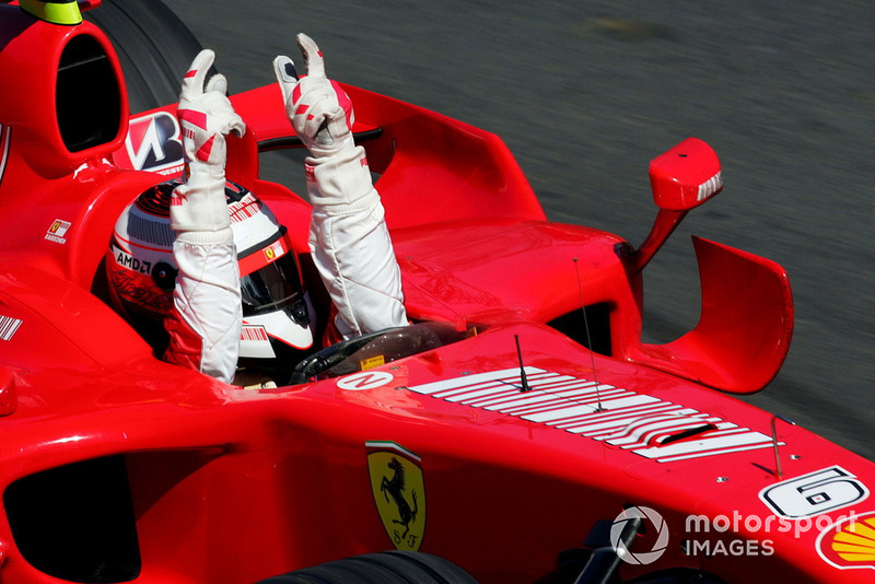 Race winner Kimi Raikkonen, Ferrari F2007 takes the chequered flag