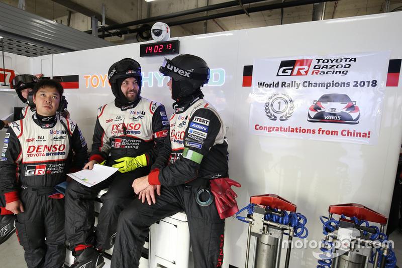 Toyota Gazoo Racing team members celebrate the manufacturer's championship in WRC