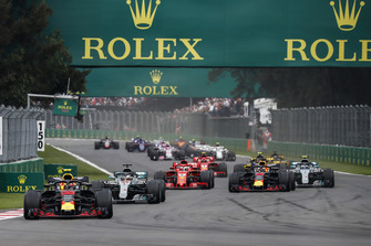 Max Verstappen, Red Bull Racing RB14 leads Lewis Hamilton, Mercedes AMG F1 W09 EQ Power+ and Daniel Ricciardo, Red Bull Racing RB14 at the start of the race