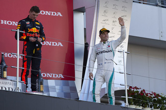 Valtteri Bottas, Mercedes AMG F1 and Max Verstappen, Red Bull Racing RB14 celebrate on the podium