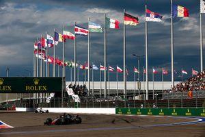 Romain Grosjean, Haas F1 Team VF-18, leads Marcus Ericsson, Sauber C37
