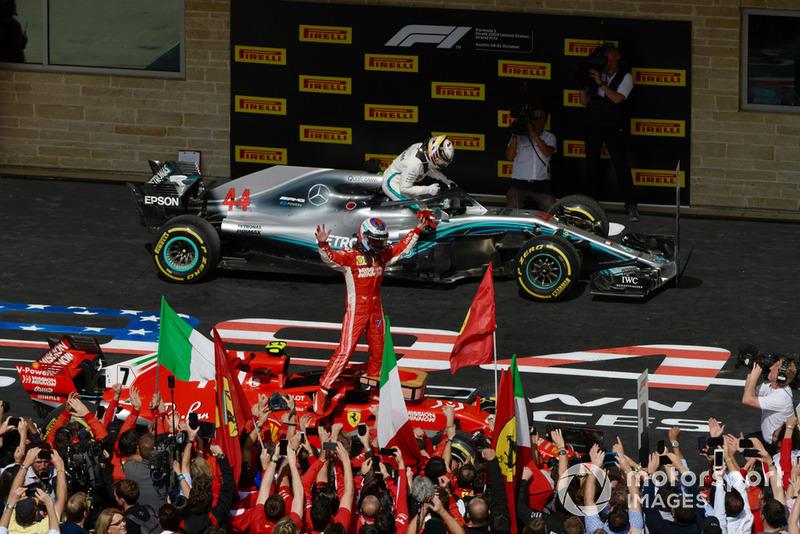 Race winner Kimi Raikkonen, Ferrari SF71H celebrates in Parc Ferme with Lewis Hamilton, Mercedes-AMG F1 W09 in back ground