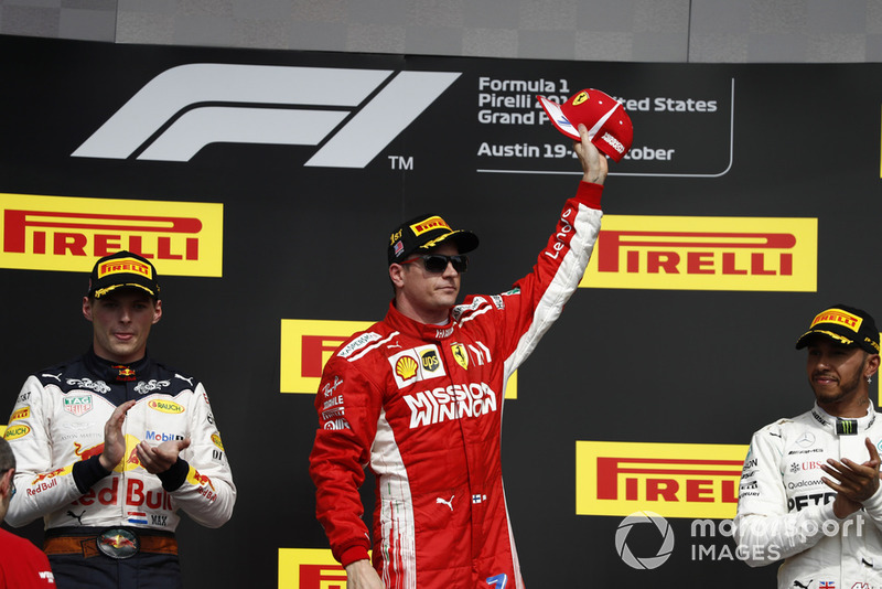Max Verstappen, Red Bull Racing, 2nd position, and Lewis Hamilton, Mercedes AMG F1, 3rd position, applaud as Kimi Raikkonen, Ferrari, 1st position, celebrates victory