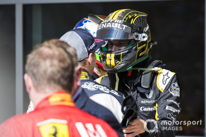 Nico Hulkenberg, Renault Sport F1 Team, congratulates Max Verstappen, Red Bull Racing, 2nd position, in Parc Ferme