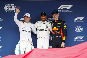 Pole position winner Lewis Hamilton, Mercedes AMG F1, celebrates between Valtteri Bottas, Mercedes AMG F1, and Max Verstappen, Red Bull Racing