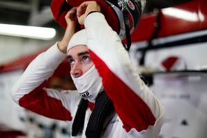 Charles Leclerc, Sauber, puts on his helmet.