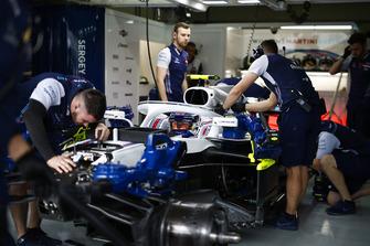 Mechanics work on the Sergey Sirotkin Williams FW41 in the team's garage