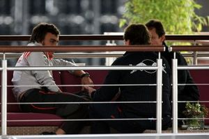 Fernando Alonso, McLaren talks with Christian Horner, Red Bull Racing Sporting Director in the Red Bull Energy Station