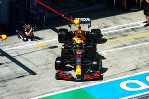 Sergio Perez, Red Bull Racing RB16B, leaves the garage
