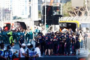 The Red Bull team celebrate victory in Parc Ferme