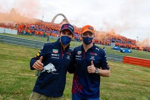 Max Verstappen, Red Bull Racing, and Sergio Perez, Red Bull Racing, greet fans before the race