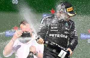 Valtteri Bottas, Mercedes, 3rd position, sprays Champagne on the podium