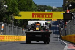 The damaged car of Max Verstappen, Red Bull Racing RB16B, on a flat bed truck