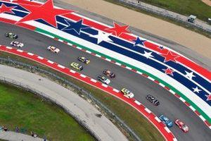 Kyle Busch, Joe Gibbs Racing, Toyota Supra Skittles Gummies and Joe Graf Jr, SS Green Light Racing, Chevrolet Camaro G Coin