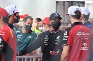 Sebastian Vettel, Aston Martin, Lewis Hamilton, Mercedes W12, and Antonio Giovinazzi, Alfa Romeo Racing C41, in the drivers parade