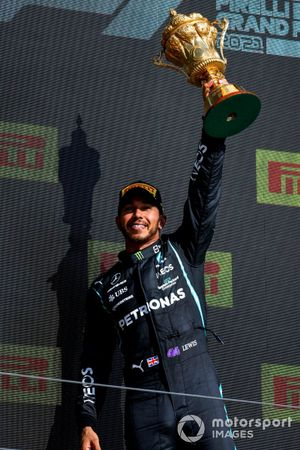 Lewis Hamilton, Mercedes, 1st position, lifts the original British Grand Prix trophy on the podium