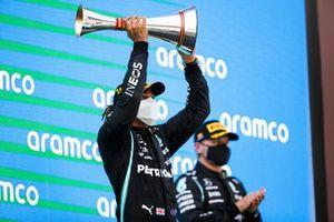 Lewis Hamilton, Mercedes, 1st position, lifts his trophy