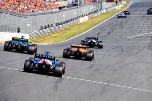 Esteban Ocon, Alpine A521, Lando Norris, McLaren MCL35M, Lance Stroll, Aston Martin AMR21, and Fernando Alonso, Alpine A521