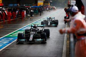 Lewis Hamilton, Mercedes W12, Valtteri Bottas, Mercedes W12, in the pit lane