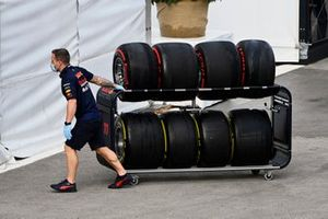 A Red Bull mechanic with some tyres