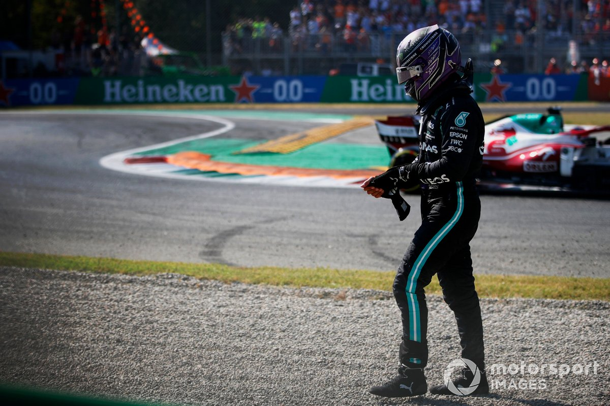 Lewis Hamilton, Mercedes, walks away after crashing out of the race with Max Verstappen, Red Bull Racing
