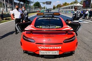 Bernd Maylander, Safety Car Driver, and the Safety Car on the grid