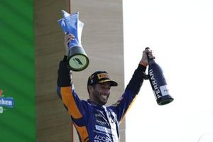 Daniel Ricciardo, McLaren, 1st position, with his trophy and Champagne