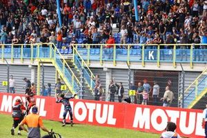 Andrea Locatelli, PATA Yamaha WorldSBK Team throws a knee slider into the crowd